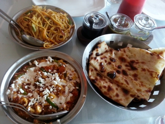 Paneer khurchan with side orders of cheese naan (right) and vegetable chowmien (top).